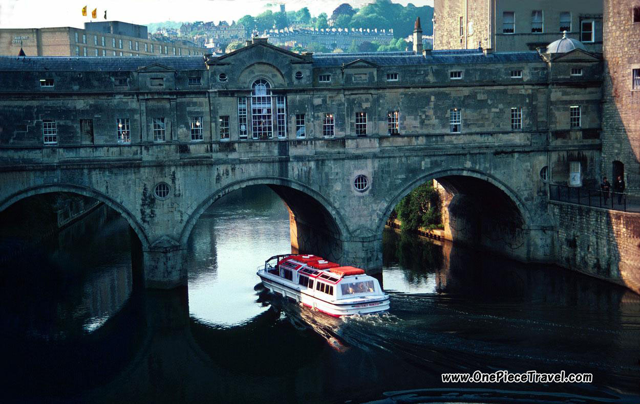 Cruising the Avon River and crossing under the Pultney Bridge; Bath, England
