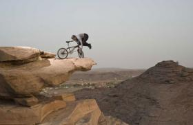 61-yr-old does balancing acts with BMX on cliff edges